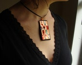 23  -Copper, red and teal recycled metal woven pendent