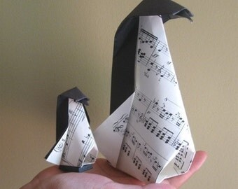 A Set Of A Large And A Little Origami Musical Penguins