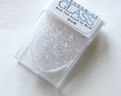 Approx. 10 grams glass clear seed beads 11o