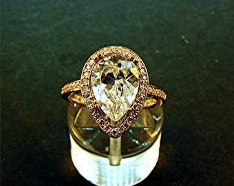 AAA 4.00 Ct 11 X 8mm. Natural Untreated Pear shape White Quartz set in a 14K  Rose gold ring with diamonds (.32ct) Ring  1230 MMM