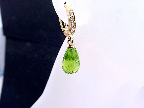 Stunning AAAA Green Tourmaline matched Set of Earrings and pendant set in 14K gold  19.49 carats total weight for all three pieces 0443