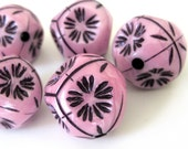 geometric pink and black flowered hexagon beads