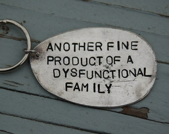 another fine product of a dysfunctional family key ring