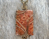 Red Coral Fossil  Wire Wrapped Pendant Necklace in Antique Bronze