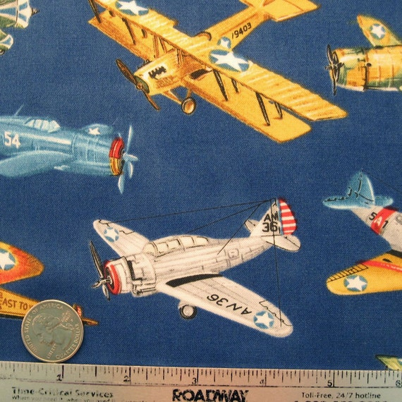Robert kaufman movin 39 on blue quilt fabric by the yard by for Airplane fabric by the yard