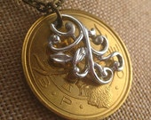 elk lodge coin necklace. silver swirls