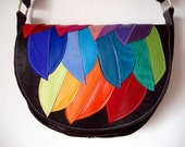 Handmade Saddle Bag in embossed black with rainbow Feathers