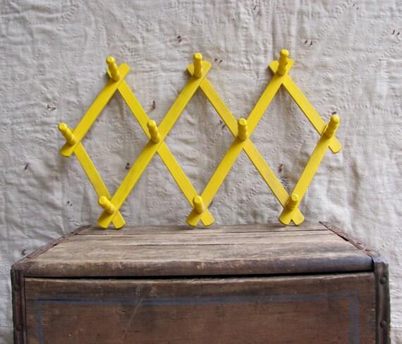 vintage c. 1960s yellow accordion rack