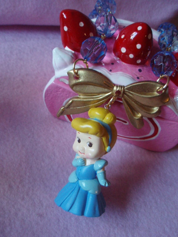 Kewpie Dressed As Cinderella Gold Bow Baby Blue Bead Necklace