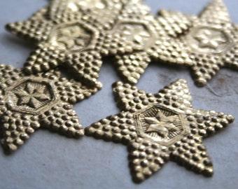 10 vintage embossed German gold paper stars