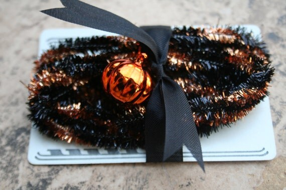 Copper Orange and Black Vintage Style Wired Tinsel Trim Narrow Halloween Decorating Supplies Twisted and Striped Metallic Garland
