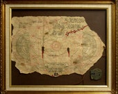 Framed Goonies map and doubloon movie prop