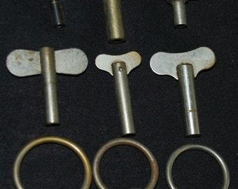 Vintage alarm clock winding knobs Steampunk keys Altered Art Mixed Media Assemblage KY 14