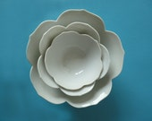 Stack of Nesting Lotus Bowls (10 Available)