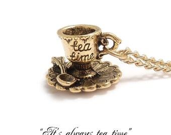 Alice in wonderland necklace .. It's always TEA TIME darling little TEACUP  necklace