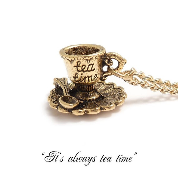 Alice in wonderland necklace .. It's always TEA TIME darling little TEACUP  necklace