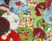 one dozen wholesale pricing assorted christmas fabric covered pocket mirrors 2.25 inches