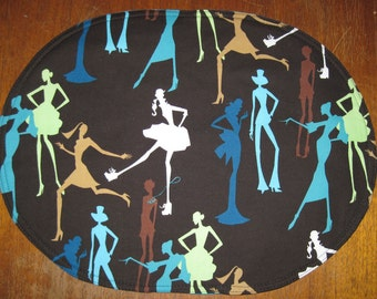 Oval placemats with stylized female silhouettes.  reversible set of 4