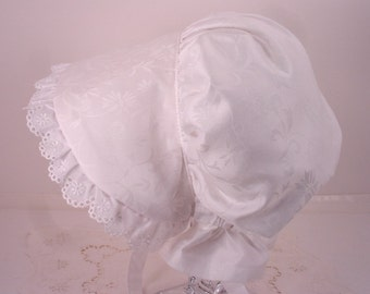Sunbonnet Hat in White Cotton to protect Child from Suns Harmful Rays