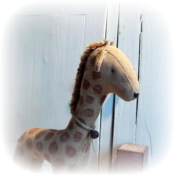 little giraffe on vintage Meccano wheels