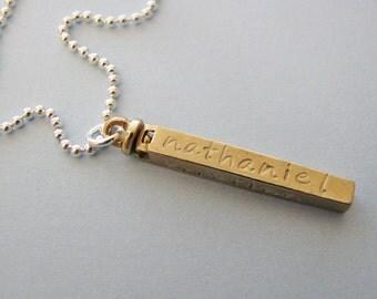 custom 4 sided swivel bar necklace in brass