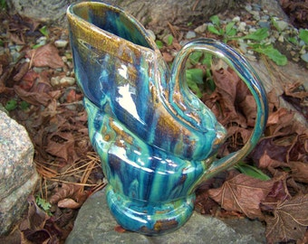 Stoneware pitcher with drippy green and blue glaze
