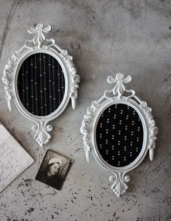 vintage. white. distressed. metal. oval. frames. filigree. fabric. black.
