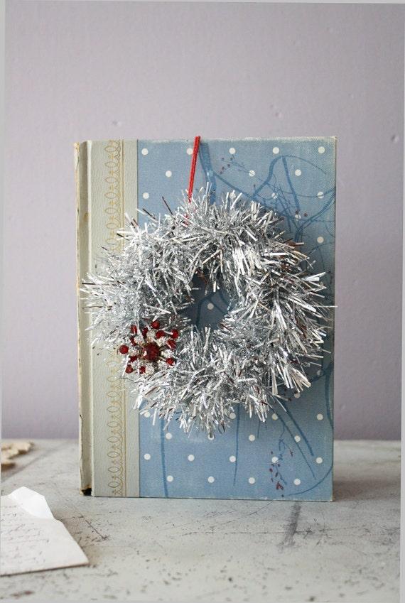 mini silver wreath. tinsel. wire. salvaged jewelry.