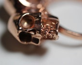 One of us. Conjoined twin skull ring. Rose gold vermeil.