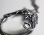 Ariel. Conjoined seahorse spyglass necklace.