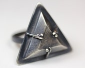 The Witches. Triangular mouse bone ring.