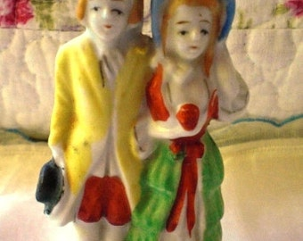 Miniature Porcelain Colonial man and Woman Taking a Stroll