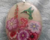 hummingbird with flowers resin pendant