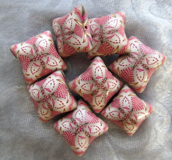 white pink and gold polymer clay pillow beads