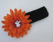 Black crochet Halloween headband w\/ an attached orange flower and white ghost button, photography prop