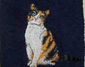 Embroidered Tabby cat on a dark blue towel personalize special