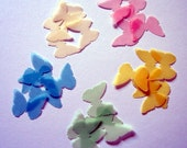 25 butterfly shaped velum punch-outs in 5 different pastel colors