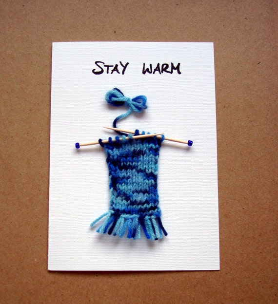 Card with hand knitted embellishment in blue - Stay warm little scarf