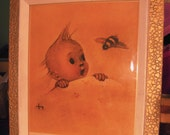 Baby's room vintage framed picture of baby in bed with Bee buzzin by artist M.