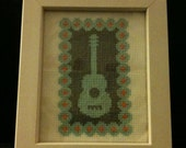 Classical guitar with rounded border pattern in frame