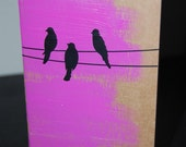Moleskine journal with birds on wire