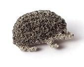 Hedgehog brooch silver and black crochet wire