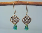 Celtic link earrings with emerald drop