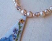 Blue Bird On A Branch Necklace
