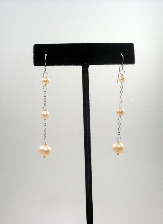 Pink Trilogy Graduating Dangling Pearl Earrings
