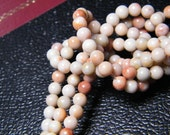 16 inch strand natural Red Spot Stone, light, 4mm round, supplies
