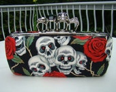 skull brass knuckle clutch with red rose and skull fabric