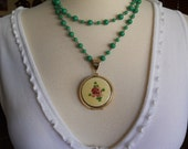 Large Vintage Enamel Locket Pale Yellow with Plum Flowers and Green Leaves on Green Glass Beaded Chain 1950s
