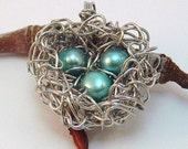 Bird's Nest Pendant with Three Blue Eggs