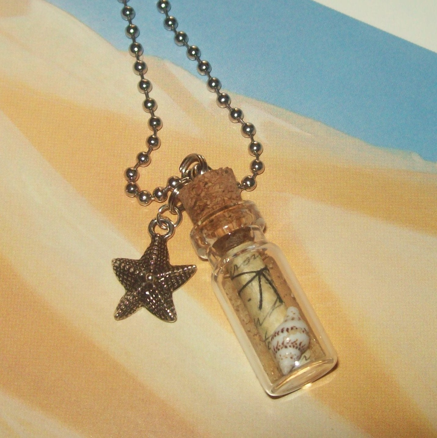 message in a bottle necklace sand and seashell w by